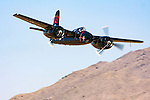 Mike Brown's F7F Tigercat, Big Bossman-Race 1, races through the Valley of Speed during the 2008 Reno National Championship Air Races. Brown piloted Big Bossman to a fourth place finish with a speed of 367.327  mph around the 58.5579 mile course in the Unlimited Silver Championship race. Photographed 09/08