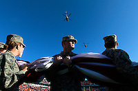 CHARLOTTESVILLE, VA- NOVEMBER 12:  The University of Virginia ROTC cadets hold a giant American Flag across the field in honor of Military Appreciation Day before the start of the Virginia Cavaliers vs/ the Duke Blue Devils football game on November 12, 2011 at Scott Stadium in Charlottesville, Virginia. Virginia defeated Duke 31-21. (Photo by Andrew Shurtleff/Getty Images) *** Local Caption ***