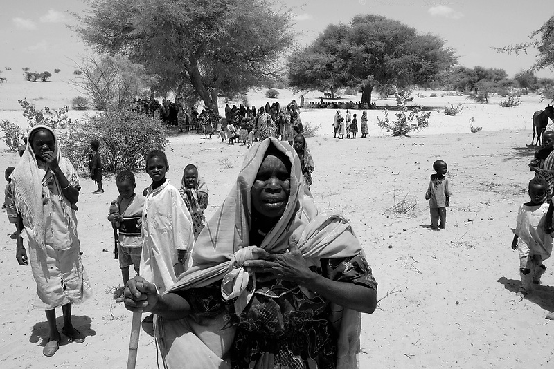 Sitek, Eastern Tchad, June 7, 2004.New Sudanese refugees show up daily on the Tchadian side of the border, this group came 2 days previously from Jebel Moun following a Janjavid attack on their village.