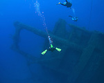 Orchid Island, Taiwan -- Divers approaching the sunken Ba Dai ship wreck.
