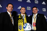 The Columbus Crew first pick and the eighth pick overall Dilly Duka (Rutgers) with head coach Robert Warzycha (L) and general manager Mark McCullers (R) during the MLS SuperDraft at the Pennsylvania Convention Center in Philadelphia, PA, on January 14, 2010.