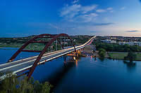"""The 360 Bridge or Pennybacker Bridge in Austin, Texas, is a through-arch bridge across Lake Austin which connects the northern and southern sections of the Loop 360 highway, also known as the """"Capital of Texas Highway."""" The road is widely considered one of the most scenic urban drives in Texas, in large part due to this arched weathering-steel bridge and the rolling hills that flank the road."""
