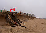 Only half of the carefully preserved sand dunes remain at Rehoboth Beach, Delaware, USA, following a major Atlantic northeast storm (nor'easter) that was spawned by the remnants of Hurricane Ida in November 2009.  The storm brought in exceptionally high tides and waves, which flooded parts of the eastern seaboard, but in Rehoboth mainly eroded the dunes and excavated the beach.