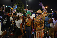 Protesters converged on the intersection of Roosevelt and State Street, briefly shutting down the major West-East artery in the South Loop in Chicago, Illinois on July 9, 2016.  Protests erupted nationwide following the police shootings of Alton Sterling who was selling bootleg DVDs outside a convenience store in Baton Rouge, Louisiana and Philando Castile during a routine traffic stop for a broken tail light in the St. Paul, Minneapolis suburb of Falcon Heights; on Thursday night, a lone gunman Micah Johnson fired and killed five police officers and injured several others during a Black Lives Matter protest in Dallas.