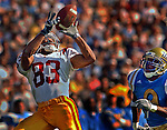 UCLA  cornerback Ricky Manning Jr. right, can only watch as USC wide receiver Keary Colbert, left, hauls in a touchdown pass during 1st quarter action of UCLA/USC game, Saturday afternoon at the Rose Bowl in Pasadena.  UCLA / USC at Rose Bowl