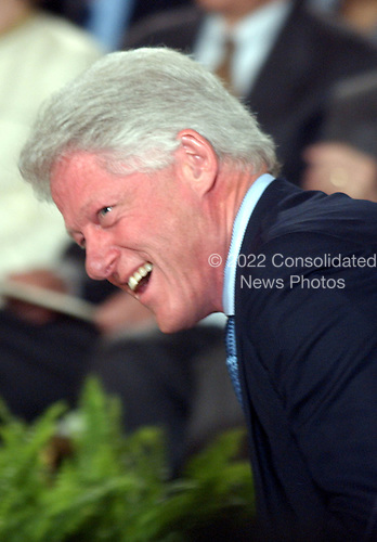 Former United States President Bill Clinton enjoys a laugh at the White House ceremony where his portrait was unveiled at the White House in Washington, D.C. on June 14, 2004.  Clinton was responding to a remark about his being the campaign chairman for George McGovern's failed presidential bid in Texas in 1972..Credit: Ron Sachs / CNP