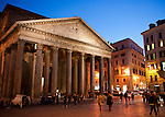 As night falls, locals and visitors mix in the Piazza della Rotonda, in front of the massive imperial Roman Pantheon in Rome, Italy.