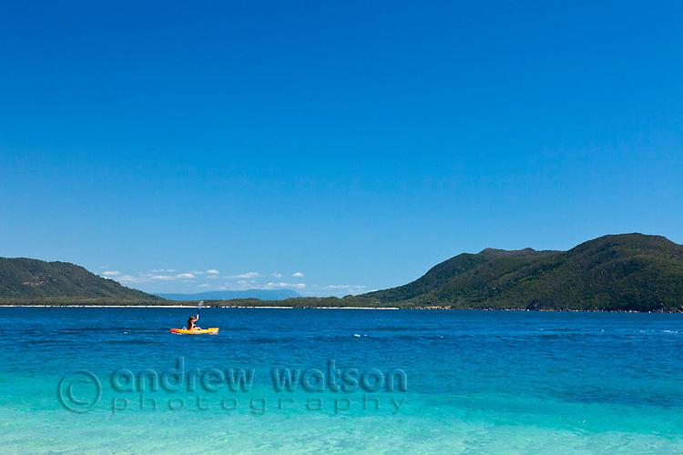 Kayaker off the coast of Fitzroy Island.  Fitzroy Island National Park, Cairns, Queensland, Austtralia