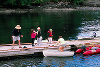 Boating Family on a Dock in Winter Cove on Saturna Island, in the Southern Gulf Islands, British Columbia, Canada