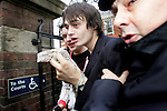 JAMES BOARDMAN / 07967642437 - 01444 412089 .Babyshambles singer Pete Doherty get a police escort as he  leaves Ealing Magistrates' Court in west London . He has been charged with possession of cocaine and heroin. .The 26-year-old frontman, whose on-off relationship with supermodel Kate Moss has made him a regular in the headlines, was arrested on November 30. .He was formally charged under the 1971 Misuse of Drugs Act for possession of the class A drugs.. .