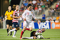 Shannon Boxx (7) of the United States (USA) goes for a tackle on Li Wen (23) of China PR (CHN). The United States (USA) women defeated China PR (CHN) 4-1 during an international friendly at PPL Park in Chester, PA, on May 27, 2012.