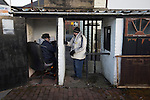 Bacup Borough 4 Holker Old Boys 1, 25/04/2016. Brain Boys West View Stadium, NorthWest Counties League Division One. The turnstile operator and a solitary spectator paying to come in to the Brain Boys West View Stadium before Bacup Borough play Holker Old Boys in a NorthWest Counties League division one fixture. Formed as Bacup in 1879, the club moved into their current home in 1889 and have been known as Bacup Borough since the 1920s, apart from a brief recent spell when they added the name Rossendale to their name. With both teams challenging for play-off places, Bacup Borough won this fixture by 4-1, watched by a crowd of 50. Photo by Colin McPherson.