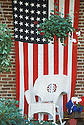 US flag, rocking chair and teddy bear on porch of Orth House B&B, Jacksonville, Oregon.