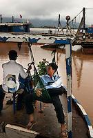Champassak, Laos, August 20, 2007.On a ferry across the Mekong.