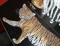 Custom Tiger bar top in Nero Marquina, Giallo Reale, Renaissance Bronze, Rosa Verona,Botticino, Crema Marfil honed and pillowed