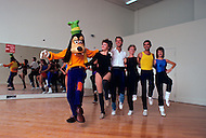 Orlando, Florida - Circa 1986. Disney character Goofy dances with Disney staff. Disney World is a world-renowned entertainment complex that opened October 1, 1971 in Lake Buena Vista, FL. Now known as the Walt Disney World Resort, the property covers 25,000 acres and has an annual attendance of 52.5million people.