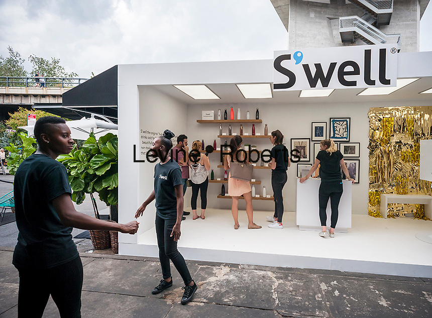 A pop-up for the designer water bottle company S'well in the Meatpacking District in New York during Fashion Week on Friday, September 9, 2016. The stainless steel bottle company founded in 2010 has collaborated with designers to make their bottles a hip accessory. (© Richard B. Levine)