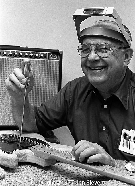 "Leo Fender, July 29, 1977, Music Man Factory, Fullerton, CA. ""American inventor who founded Fender Electric Instrument Manufacturing Company, now known as Fender Musical Instruments Corporation, and later founded MusicMan and G&L Musical Products (G&L Guitars). His guitar, bass, and amplifier designs from the 1950s continue to dominate popular music more than half a century later. Marshall and many other amplifier companies have used Fender instruments as the foundation of their products. Fender and inventor Les Paul are often cited as the two most influential figures in the development of electric instruments in the 20th century."""