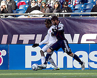 DC United forward Joseph Ngwenya (11) dribbles as New England Revolution defender Franco Coria (2) defends. In a Major League Soccer (MLS) match, the New England Revolution defeated DC United, 2-1, at Gillette Stadium on March 26, 2011.