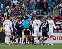 Late game frustration yields a red card for DC United defender Dejan Jakovic (5). In a Major League Soccer (MLS) match, the New England Revolution defeated DC United, 2-1, at Gillette Stadium on March 26, 2011.