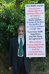 Bradwell on Sea Essex England. 2009. Religious protester a member of the Strict Baptist church. This Elder holds a banner in protest against the Church of Rome interpretation of part of the Bible.