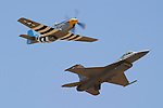 The United States Air Force Heritage Flight featuring and modern day F-16C Fighting Falcon and a World War II era P-51D Mustang display airpower seperated by 50 years during the 2005 Warbirds in Action Airshow at Minter Field near Shafter, California.