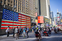 "Tourist wander through Times Square in New York on Wednesday, September 17, 2014. NYPD Commissioner Bill Bratton recently announced that the terrorist group ISIS (ISIL) had mastered social media and are encouraging  ""lone wolf"" terrorists to bomb or commit mass murder in soft targets, with highly visible Times Square on the top of their list. (© Richard B. Levine)"