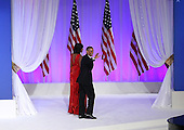United States President Barack Obama (R) and first lady Michelle Obama walk off of stage after appearing at the Commander-in-Chief Ball on January 21, 2013 in Washington, DC. Pres. Obama was sworn-in for his second term as president during a public ceremonial inauguration earlier in the day..Credit: Justin Sullivan / Pool via CNP