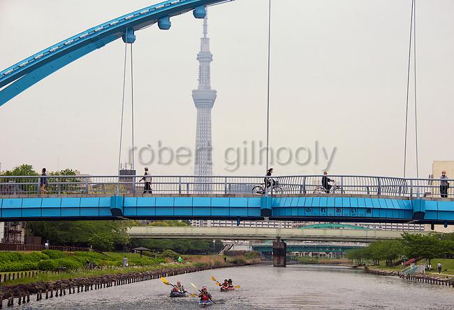 Kayakers paddled below Fureai Bridge that spans the Onagigawa River in Koto Ward, Tokyo, Japan. ROB GILHOOLY