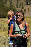 Woman hiking with her child on the Sagehen Creek trail, Tahoe National Forest California
