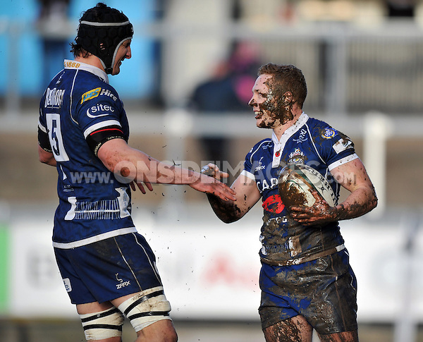 Luke Baldwin is congratulated by Mark Sorenson after scoring a try for Bristol. Greene King IPA Championship match, between Bristol Rugby and Jersey on February 2, 2014 at the Memorial Stadium in Bristol, England. Photo by: Patrick Khachfe / JMP