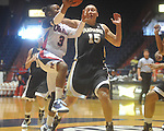 "Mississippi's Valencia McFarland (3) shoots as Vanderbilt's Hannah Tuomi (15) defends at the C.M. ""Tad"" Smith Coliseum in Oxford, Miss. on Sunday, January 2, 2011. (AP Photo/Oxford Eagle, Bruce Newman)"