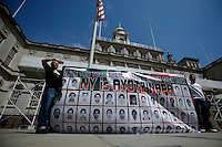 Parents and relatives of the missing 43 students of Ayotzinapa, Mexico, hold a banner with the faces of the students while they attend a press conference at the steps of the New York City Hall in New York.  04/22/2015. Eduardo MunozAlvarez/VIEWpress