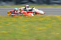 Karl Wilson, NZ, and Robin Wooldridge, 15, race in the International Superkarts class during the 2012 Superkart National Champs and Grand Prix at Manfeild in Feilding, New Zealand on Saturday, 7 January 2011. Credit: Hagen Hopkins.
