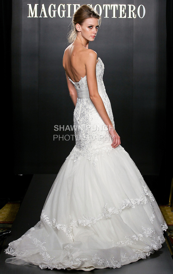Model walks the runway in a Mandy Haute Couture wedding dress from the Maggie Sottero Bridal Spring 2012 collection, during  Couture: New York Bridal Fashion Week 2012