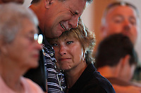 PUNTA GORDA, FL -- March 13, 2008 -- Kevin Hall cries with his wife, Becky Hall, during a gunshot salute and taps as they mourn the loss of their son during a memorial service for former Marine Eric Hall at the Faith Lutheran Church in Punta Gorda, Fla., on Thursday, March 13, 2008.  Hall went missing on Feb. 3 after having a flashback to his time in Iraq, and was found dead weeks later by the Vietnam veteran volunteers in a culvert.