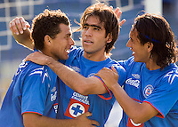 Cesar Delgado (C) is congratulated by his teammates Miguel Sabah (L) and Alejandro Corona after scoring a goal against Veracruz Tiburones Rojos during their soccer match at Azul Stadium, April 08, 2006.Cruz Azul won 3-0 to Veracruz...  © Photo by Javier Rodriguez