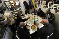 Vecchi amici. Old friends..Nello storico quartiere di San Lorenzo a Roma, un gruppo di amici si riunisce per pranzo,nella falegnameria di Graziano Azzurri.L' occasione è il compleanno di Vincenzo, 76 anni ex tassista..In the historic district of  San Lorenzo in Rome, a group of friends meets for lunch, in carpentry of Graziano Azzurri. On the occasion of the birthday of  Vincenzo, 76 years ex taxi driver....