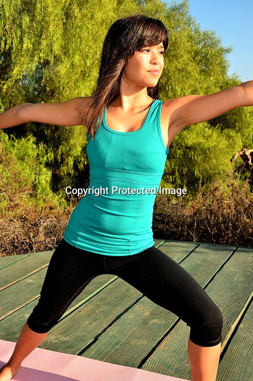 Young asian woman doing yoga
