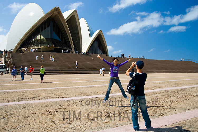 Tourists taking photographs at Sydney Opera House,  New South Wales, Australia