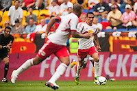 Tim Cahill (17) of the New York Red Bulls passes the ball to Thierry Henry (14). The New York Red Bulls defeated the Houston Dynamo 2-0 during a Major League Soccer (MLS) match at Red Bull Arena in Harrison, NJ, on June 30, 2013.