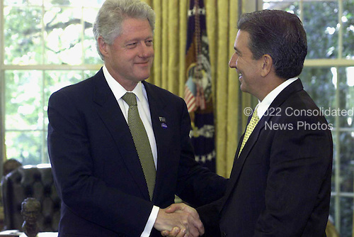 United States President Bill Clinton greets Governor Pedro Rossello of Puerto Rico in the Oval Office at the White House in Washington, D.C. on October 30, 2000..Mandatory Credit: David Scull / White House via CNP