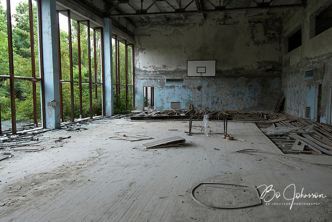 Looting in the gymnasium - somebody have tried to steal the wooden floor - of the swimming hall &quot;Azure&quot; in Pripyat.<br />