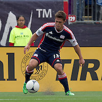 New England Revolution midfielder Ryan Guy (13) at midfield. In a Major League Soccer (MLS) match, the New England Revolution defeated Portland Timbers, 1-0, at Gillette Stadium on March 24, 2012