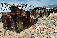 Shacks and garbage in the slum of Cité Soleil, Port-au-Prince, Haiti, 16 July 2008. Cité Soleil is considered one of the worst slums in the Americas, most of its 300.000 residents live in extreme poverty. Children and single mothers predominate in the population. Social and living conditions in the slum are a human tragedy. There is no running water, no sewers and no electricity. Public services virtually do not exist - there are no stores, no hospitals or schools, no urban infrastructure. In spite of this fact, a rent must be payed even in all shacks made from rusty metal sheets. Infectious diseases are widely spread as garbage disposal does not exist in Cité Soleil. Violence is common, armed gangs operate throughout the slum.