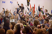NWA Democrat-Gazette/BEN GOFF @NWABENGOFF<br /> Students cheer after joining in a sing-a-long with Martin and Nellie Beggs of Sydney, Australia (not pictured) Monday, Feb. 13, 2017, during a presentation at R.E. Baker Elementary in Bentonville. Husband and wife Martin and Nellie Beggs have been presenting their 'Australian Kaleidoscope' program at schools in the United States for over ten years for the Kansas City, Mo. company 'The Cultural Kaleidoscope'. Students joined in songs and Aboriginal dances as they learned about the natural and cultural history of 'The Land Down Under' in assemblies and classes throughout the day.