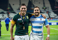Bath Rugby team-mates Francois Louw of South Africa and Horacio Agulla of Argentina pose for a photo after the match. Rugby World Cup Bronze Final between South Africa and Argentina on October 30, 2015 at The Stadium, Queen Elizabeth Olympic Park in London, England. Photo by: Patrick Khachfe / Onside Images