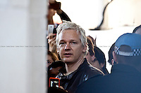Julian Assange - 2011<br /> <br /> London, 15/10/2011. St Paul's Square became the stage of the UK arm of the &quot;Occupy&quot; protest movement which has been growing around the world. The Occupy movement is a world-wide protest against the financial crises created by the actual financial system, by speculation, by deregulation, and by the actions of major international financial and investment banks. Around 2,000 protesters armed with tents and placards, gathered outside the famous Cathedral intending to occupy Paternoster Square, home of the London Stock Exchange and the heart of the City of London, but they were hampered by City police officers. After this failed attempt the protesters decided to camp in front St Paul's where the situation with police forces became immediately tense. Masked like the character of Guy Fawkes from the movie &quot;V for Vendetta&quot;, Julian Assange appeared on the square to give a speech in support of the protesters. During the late evening police forces heavily armed with riot control equipment charged the square, attempting to evict the occupants who resisted. Later in the evening the police retreated and the occupation continued peacefully.