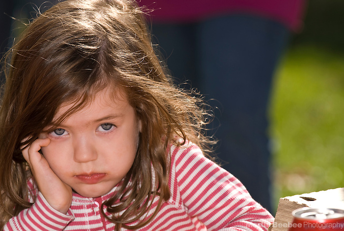 A three-year-old girl looking bored