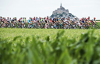 Picture by Alex Broadway/ASO/SWpix.com - 17/04/2016 - Cycling - Tour de France 2016 - Stage One - Mont-Saint-Michel to Utah Beach Sainte-Marie-du-Mont - The peloton passes Mont-Saint-Michel.<br /> NOTE : FOR EDITORIAL USE ONLY. COMMERCIAL ENQUIRIES IN THE FIRST INSTANCE TO simon@swpix.com THIS IS A COPYRIGHT PICTURE OF ASO. A MANDATORY CREDIT IS REQUIRED WHEN USED WITH NO EXCEPTIONS to ASO/ALEX BROADWAY